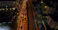 Aerial video Collins Avenue Sunny Isles Beach at night 4k 24p Stock Footage