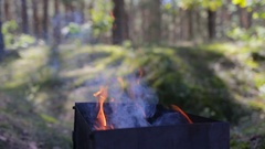 Man rake the coals in the brazier Stock Footage