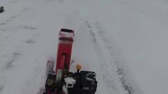 Snowplowing driveway slomo Stock Footage