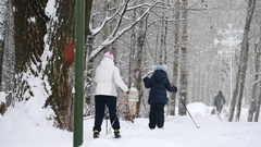 Healthy sport family - mammy and child - skiers in winter snow park Stock Footage