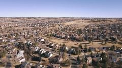 Aerial view of residential neighborhood in suburbia in snowless Winter. Stock Footage