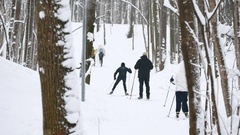 Healthy sport family moving slides ski in winter snow forest Stock Footage