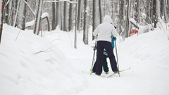 Healthy sport family - mammy and child - skiers in winter snow forest Stock Footage