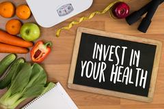 Invest in your health , Healthy lifestyle concept with diet and fitness , G.. Stock Photos