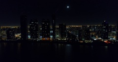 Moon over the city Stock Footage