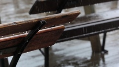 Empty Bench in a Street Cafe and Rain. Slow Motion Stock Footage
