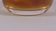 Scotch on the rocks. Close up of Whiskey in a glass with ice. 4K UHD. Stock Footage