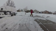 Removing snow by shovel in the driveway. Stock Footage