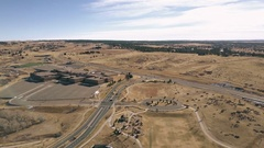 Aerial view ofsuburban high school in snowless Winter. Stock Footage