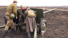 Three Soviet soldiers charged Artillery antitank gun live ammunition Stock Footage