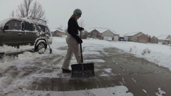 Snow removal on a cold winter day Stock Footage