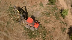 Aerial shot of pine logging forwarder machinery collecting tops Stock Footage
