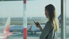 Girl Waiting for a Flight at the Airport Stock Footage