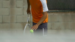 Male tennis player serving during match, slow motion. Stock Footage