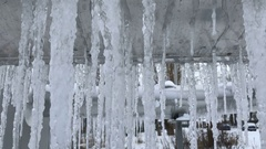 Icicles on a large metal tube Stock Footage
