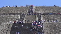 Tourists climbing Teotihuacan moon pyramid - Mexico City Stock Footage