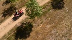 Farmer rides a quad bike, aka quadbike, without helmet Stock Footage