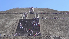 People climbing Teotihuacan moon pyramid - Mexico City Stock Footage