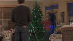 Time Lapse of Christmas Tree Being Decorated in 4K Stock Footage