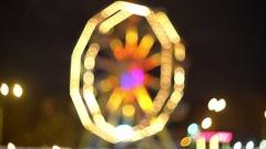 Defocused night amusement park, the beautiful background of bright light Stock Footage