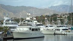 Tropical luxury yacht marina with mountains - port of San Jose del Cabo, Mexico Stock Footage