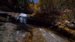 MoCo Astro Timelapse of Fall Foliage Waterfalls in Eastern Sierra -Zoom In- Stock Footage