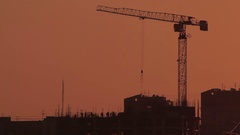 Group of workers build house on sunset sky background Stock Footage