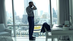 Businessman having head pain and drinking water in office, super slow motion  Stock Footage