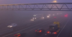 Highway traffic in mist - interchange A12, The Netherlands Stock Footage
