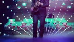 Playing saxophone in night club no face close up hands and legs only Stock Footage