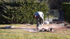Worker cutting bricks with circular electric saw Stock Footage