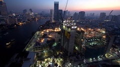 4K : Day to night, Construction site on Chao Phraya riverside in Bangkok Stock Footage