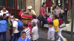 Traditional Mexican street musician, organ grinder - Mexico City downtown Stock Footage