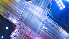 Vertical top down aerial view of traffic on street intersection at night. Stock Footage
