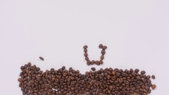 Coffee beans in shape of cup and smiley face Stock Footage