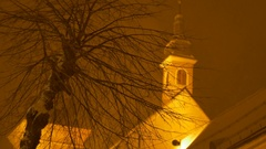 Snowy Night Tree and Church Stock Footage