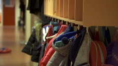 Children's coats at primary school Stock Footage