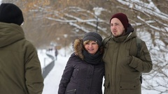 Portrait of a happy family standing on the winter alley and smiles Stock Footage
