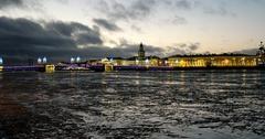 Sunset, frozen river Neva, illuminated Vasilievsky island in St. Petersburg Stock Footage