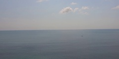 Sea Plane flyby in the distance over ocean. Stock Footage