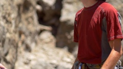 A rock climber putting chalk on his hands for better grip, slow motion. Stock Footage