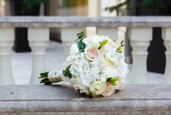 Beautiful wedding bouquet on vintage marble banister Stock Photos