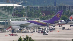 Cars of airport services and planes Stock Footage