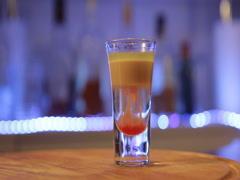 Hiroshima alcoholic cocktail, bomber shot, close up, slowly moving camera Stock Footage