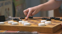 Little boys playing checkers at the garden Stock Footage