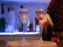 Aviation cocktail. Barman's hands mixing cocktail, preparing alcoholic drink Stock Footage