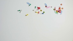 Rain of paper pins and clips Stock Footage
