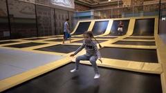 Girl kid jumping on the trampoline having fun Stock Footage