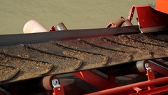 The sand is transported on a conveyor belt to be machined. Detail. Stock Footage