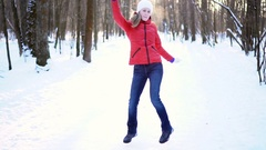 Attractive young woman dancing silly and funny in a winter park, having fun Arkistovideo